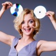 Girl keeps disks — Stock Photo