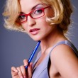 Stock Photo: Businesswoman in red glasses