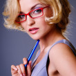 Businesswoman in red glasses — Stock Photo