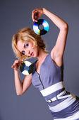 Girl keeps disks — Stock Photo