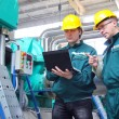 Industrial workers with notebook, teamwork — Stock Photo #10814995