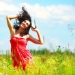 Stock Photo: Happy beautiful womdancing in meadow
