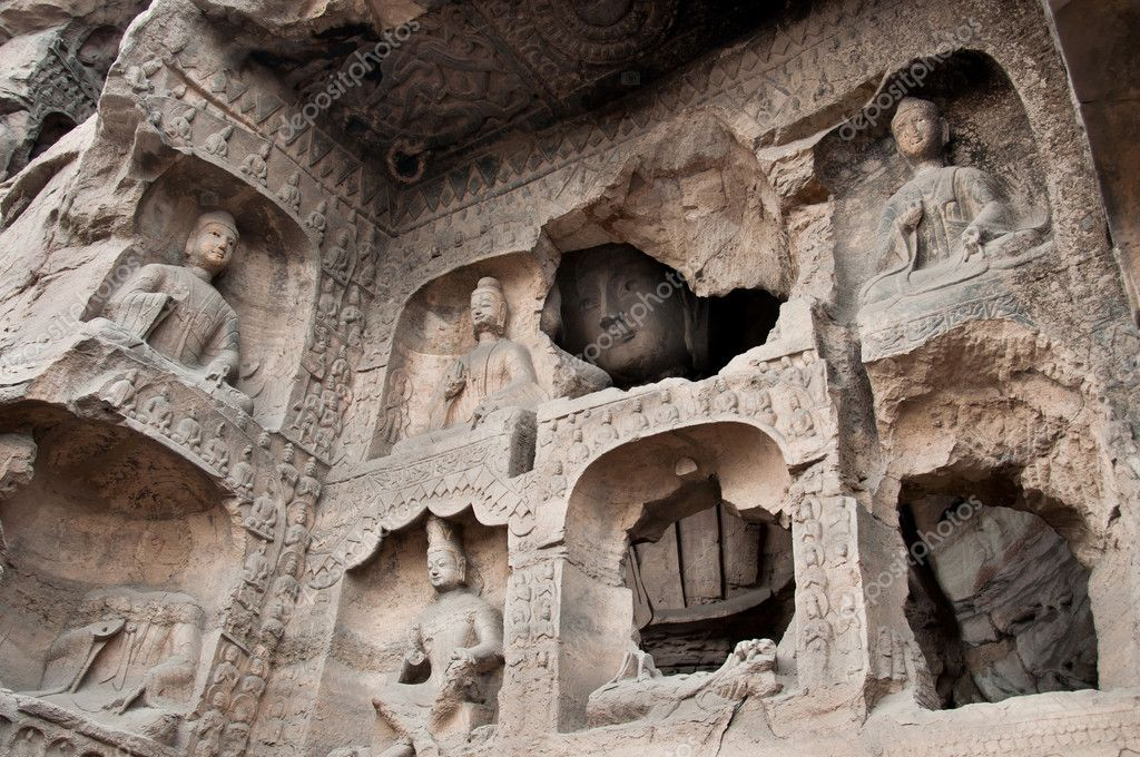 The Yungang Caves are ancient Chinese Buddhist temple grottoes near the city of Datong in the province of Shanxi. They are excellent examples of rock-cut architecture and one of the three most famous ancient Buddhist sculptural sites of China.  Stock Photo #10758648