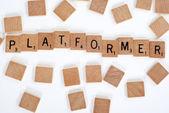Scrabble tiles spell out 'Platformer' — Stock Photo