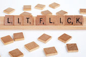 'Lit Flick' spelled with Scrabble tiles — Zdjęcie stockowe