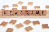 Scrabble tiles spell out 'Newsgame' — Stock Photo