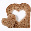 Whole wheat bread with heart — Stock Photo