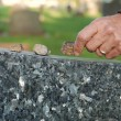 Placing stone on tombstone — Stock Photo #11994775