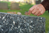 Placing stone on tombstone — Stock Photo