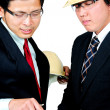 Stock Photo: Two asiengineers discussed