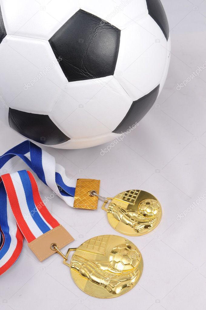 Soccer ball and Golden medal with white background — Stock Photo #11487867