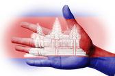 ásia torcendo fã com pintura a bandeira nacional do camboja — Foto Stock