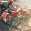 Tractor and seeder - Stock Photo