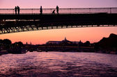 Old bridge silhouette over the river — Foto Stock