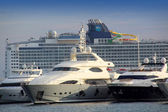 Large luxury yachts and passenger cruise ferry boat in the harbor of Cannes, — Stock Photo