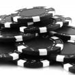 Black poker chips — Stock Photo