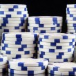 Stack of white casino gambling chips - Stock Photo