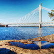 Bridge with reflection in puddle on coast — Stock Photo