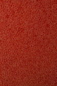Red plastic sponge macro — Stock Photo