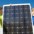 Happy Teeens with solar panel — Stock Photo