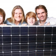 Happy Familiy with solar panel - Foto Stock