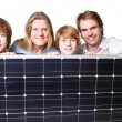 Happy Familiy with solar panel - Stockfoto