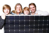 Happy Familiy with solar panel — Stock fotografie