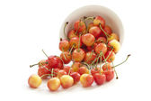 Sweet cherry in a white bowl — Stock Photo