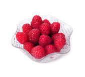 Raspberries in a crystal bowl isolated on white background — Stock Photo