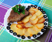 Veal with fried potatoes on a plate — Stock Photo