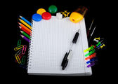 School education supplies items isolated on a black background — Stock Photo