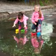 Stock Photo: Girls playing in puddle