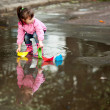 Stock Photo: Girl playing in puddle