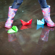 Stock Photo: Rain boots in puddle