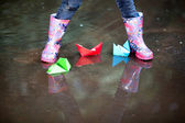 Rain boots in puddle — Stock Photo