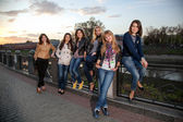 Girls on the river bank — Stockfoto