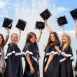 Stock Photo: Graduates near fountain