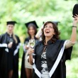 Stock Photo: Bachelor's graduates celebrate