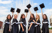 Graduates near the fountain — Stock Photo