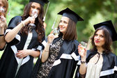 Bachelor's graduates celebrate — Stock Photo