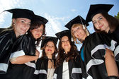 A group of girls in gowns of graduates — Foto de Stock
