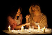 Divination by candlelight — Stock Photo