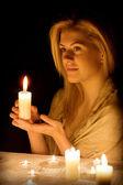 Mujer con una vela — Foto de Stock
