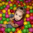 Girl with colorful balls - Stock Photo