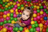 Girl with colorful balls — Stock Photo