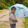 Child and umbrella — Stock Photo