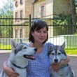 The woman with dogs — Stock Photo #11441922