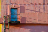 Blue,metal warehouse entry door with stairs — Stock Photo
