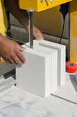 Mason working with construction blocks made from aerated concrete — Stock Photo