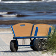 Stock Photo: Lonely handcart standing on way to beach